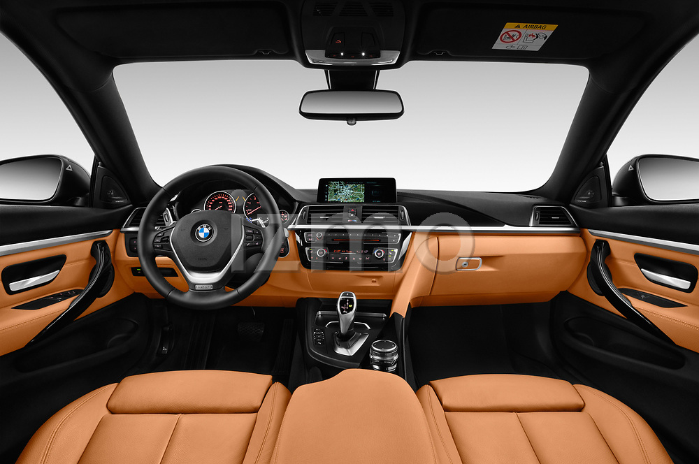 Stock photo of straight dashboard view of a 2018 BMW 4 Series Luxury 4 Door Coupe