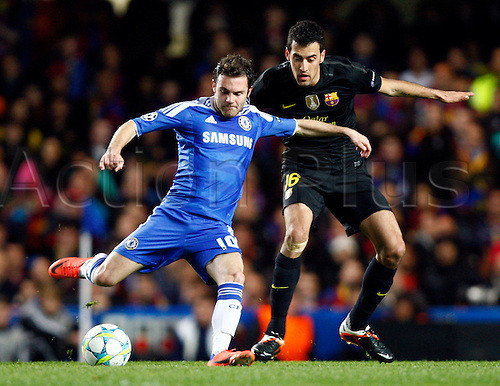 18.04.2012. Stamford Bridge, Chelsea, London.  Chelsea's Juan Mata and Sergio Busquets of  FC Barcelona during the Champions League Semi Final 1st  leg match between Chelsea and Barcelona  at Stamford Bridge, Stadium on April 18, 2012 in London, England.