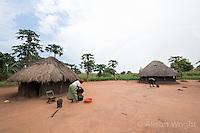 N. Uganda, Gwendiya, Gulu District. Women in front of their round thatched huts.