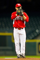 Starting pitcher Chase Wellbrock #15 of the Houston Cougars looks to his catcher for the sign against the Texas A&M Aggies at Minute Maid Park on March 6, 2011 in Houston, Texas.  Photo by Brian Westerholt / Four Seam Images