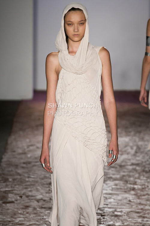 Model walks runway in a white pokot macrame combro dress from the Kimberly Ovitz Spring 2013 runway show at Pier 57, during New York Fashion Week on September 6, 2012.