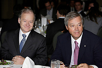 Montreal (Qc) CANADA -April 27 2009 -Raymond Bachand, Quebec Finance Minister (L)sit beside  Jacques L Menard, CEO, Quebec division, Bank of Montreal (BMO)before he speak at the Canadian Club of Montreal's podium on education and school drop out in Quebec.
