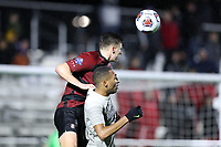 CARY, NC - DECEMBER 13: Cam Cilley #16 of Stanford University heads the ball over Derek Dodson #9 of Georgetown University during a game between Stanford and Georgetown at Sahlen's Stadium at WakeMed Soccer Park on December 13, 2019 in Cary, North Carolina.