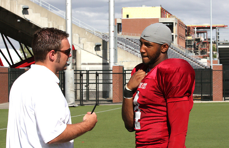 Brandon Gibson, the outstanding senior wide receiver for the Washington State Cougars, talks with Assistant Director of Sports Information at WSU, Joe Nickell, following football practice in Pullman, Washington, on August 10, 2008.