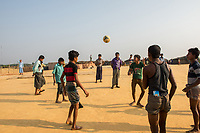 Bangladesh, Cox's Bazar. Kutupalong Rohingya Refugee Camp. The Rohingya, a Muslim ethnic group  denied citizenship in Burma/Myanmar have escaped persecution from Burmese militants in their country. There are up to 500,000 refugees and migrants living in makeshift camps in Cox's Bazar. Boys playing soccer.