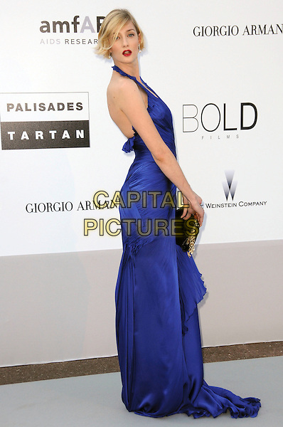 EVA RICCOBONO.arrivals at amfAR's Cinema Against AIDS 2010 benefit gala at the Hotel du Cap, Antibes, Cannes, France during the Cannes Film Festival.20th May 2010.amfar full length cobalt blue long maxi dress side ruched halterneck black clutch bag .CAP/CAS.©Bob Cass/Capital Pictures.
