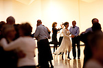 Couples, including Ed Dittell and Pina Tomassi (back), dance at the Singles Dance at the Sundial Auditorium in Sun City Friday night, January 8, 2010.