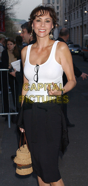 MARIE HELVIN.At the opening of The Saatchi Gallery, County Hall, London..15th April 2003.white tank top, glasses, half length, half-length.www.capitalpictures.com.sales@capitalpictures.com.Supplied By Capital PIctures
