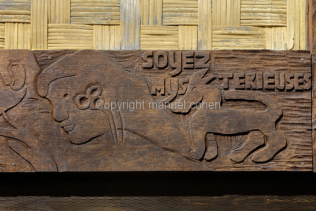 Wooden lintel carved by Gauguin in 1901 with the inscription, 'Be mysterious. Be loving and you will be happy', on the reconstruction of the Maison du Jouir or House of Pleasure, a traditional 2-storey hut and home to French artist Paul Gauguin, 1848-1903, from 1901 to his death, now part of the Paul Gauguin Cultural Center, a museum which opened in 2003, in Atuona, on the island of Hiva Oa, in the Marquesas Islands, French Polynesia. Picture by Manuel Cohen