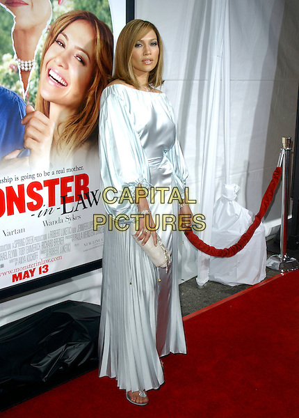 "JENNIFER LOPEZ.At New Line Cinema's Los Angeles Premiere of ""Monster-in-Law"" held at The Mann National Theatre in Westwood, California, USA,.April 29th 2005..full length blue satin long sleeved dress puffy sleeves seventies style hair bob pleated skirt clutch bag.Ref: DVS.www.capitalpictures.com.sales@capitalpictures.com.©Debbie VanStory/Capital Pictures"