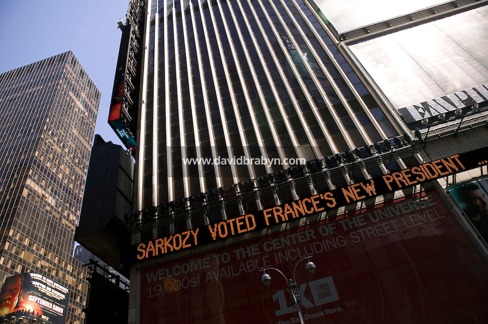 """6 May 2007 - New York City, NY - A message reading """"Sarkozy voted France's new president"""" scrolls on the Dow Jones zipper in Times Square in New York City, USA, 22 April 2007, to announce Nicolas Sarkozy's victory in the French presidential elections."""