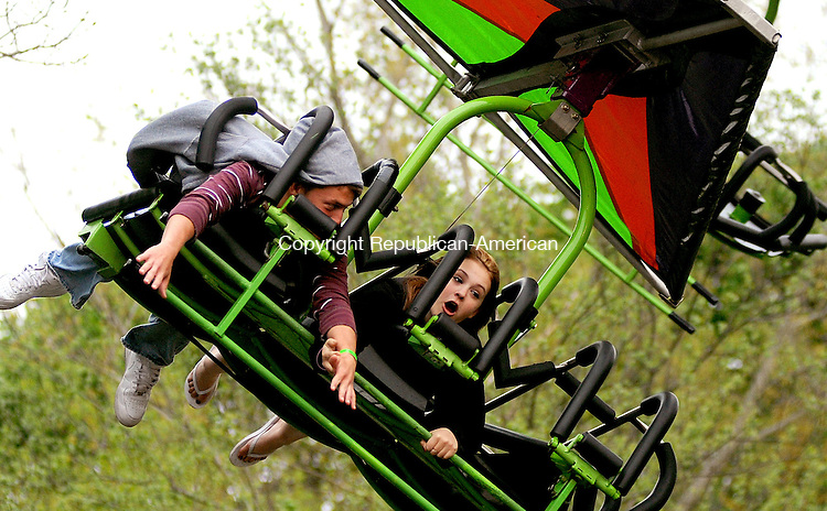 WATERTOWN,  CT, 01 MAY 2012-050212JS14- Cory Winkelmann, 19, of Watertown and Alyssa Sosbe, 17, of Watertown, enjoy a ride on the Cliff Hanger during the annual St. Mary Magdalen Parish School carnival Tuesday at the school in Watertown. The carnival runs Wednesday through Friday from 6-10 pm and Saturday from 5-10 pm..Jim Shannon Republican-American