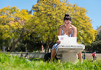 Isabel Morales '20 studies for a Spanish test near the Gilman Fountain, March 28, 2018.<br /> (Photo by Marc Campos, Occidental College Photographer)