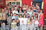 Communion party.---------------.Rachel Quirke, Hawley Pk and Chantelle O'Sullivan, Kevin Barrys, Tralee (both standing centre) celebrated their First Holy Communion with a great afternoon with their parents, relatives and friends at the Munster bar, Ballymullen, Tralee on Saturday.   Copyright Kerry's Eye 2008