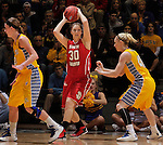 SIOUX FALLS, SD - MARCH 12:  Margaret McCloud #30 of the University of South Dakota looks to pass between South Dakota State defenders during their championship game at the 2013 Summit League Tournament at the Sioux Falls Arena Tuesday. (Photo by Dick Carlson/Inertia)