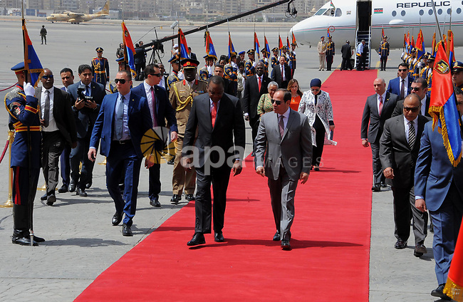 Egyptian President Abdel Fattah al-Sisi welcomes Kenyan President Uhuru Kenyatta upon his arrival at Cairo's international airport in Cairo, Egypt, on May 10, 2017. Photo by Egyptian President Office