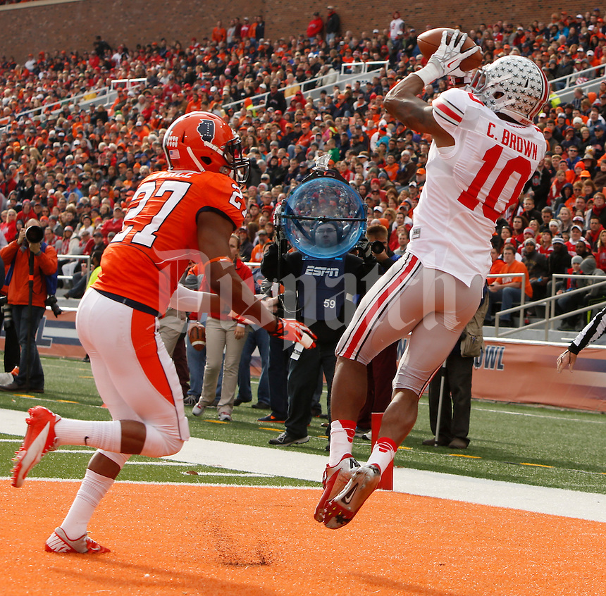 Ohio State Buckeyes wide receiver Philly Brown (10) catches a pass from Ohio State Buckeyes quarterback Braxton Miller (5) for a touchdown while defended by Illinois Fighting Illini defensive back Eaton Spence (27) in the second quarter during Saturday's NCAA Division I football game at Memorial Stadium in Champaign, Il., on November 16, 2013. Ohio State led at halftime with a score of 35-14. (Barbara J. Perenic/The Columbus Dispatch)