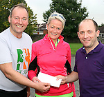 Ardee 5K and 10K Ferdia Challenge sponsored run event in aid of St John of God, Drumcar and the Special Care Baby Unit, Our Lady of Lourdes Hospital, Drogheda organisers Frank Lynch (left) and Patricia Bannon being presented with a cheque by main sponsor Bobby Corrigan of Ultimate Security Technologies, Ardee Photo:Colin Bell/pressphotos.iePhoto:Colin Bell/pressphotos.ie