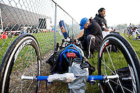 Shawn sets up Minda's handcycle and racing wheelchair in the bicycle and running transition area before the start of the New Jersey Devilman Triathlon on May 5, 2012 in Cumberland County, New Jersey.