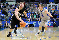 December 12, 2015 - Colorado Springs, Colorado, U.S. -  Army guard, Kyle Wilson #21, drives the baseline during an NCAA basketball game between the Army West Point Black Knights and the Air Force Academy Falcons at Clune Arena, U.S. Air Force Academy, Colorado Springs, Colorado.  Army West Point defeats Air Force 90-80.
