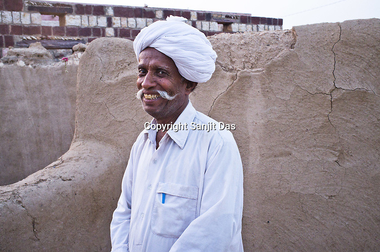 66-year-old Manganiyar artist, Lakha Khan poses for a portrait outside his house in Raneri village of Jodhpur district in Rajasthan, India. Photo: Sanjit Das/Panos