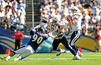 Sep. 20, 2009; San Diego, CA, USA; San Diego Chargers quarterback (17) Phillip Rivers drops back to pass as tackle (66) Jeromey Clary defends against Baltimore Ravens defensive end (90) Trevor Pryce at Qualcomm Stadium in San Diego. Baltimore defeated San Diego 31-26. Mandatory Credit: Mark J. Rebilas-