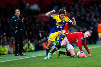 Sunday 05 January 2014<br /> Pictured: Alejandro Pozuelo and Alexander B?ttner  clash <br /> Re: Manchester Utd FC v Swansea City FA cup third round match at Old Trafford, Manchester