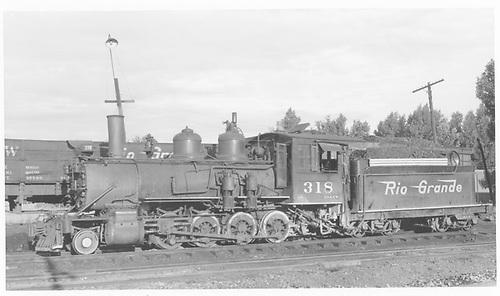 Fireman's-side view of D&amp;RGW #318 at Montrose.<br /> D&amp;RGW  Montrose, CO  Taken by Maxwell, John W. - 7/13/1946