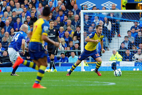 23.08.2014.  Liverpool, England. Premier League. Everton versus Arsenal. Arsenal midfielder Aaron Ramsey runs with the ball