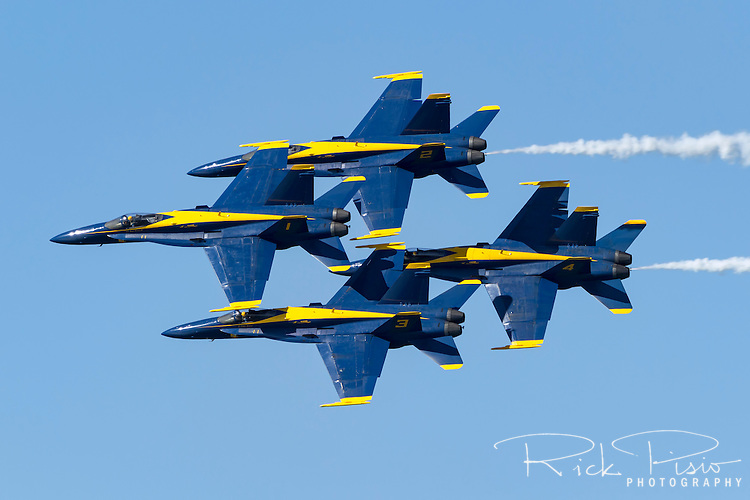 The Blue Angels in diamond formation pass overhead during 2016 San Francisco Fleet Week activities. The U.S. Navy Blue Angel's fly the Boeing built F/A-18 Hornet.