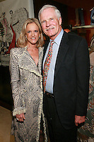 """Ted Turner and guest at the Rebecca Moses """"A Life of Style"""" book signing at Fratelli Rossetti Boutique, November 11, 2010."""