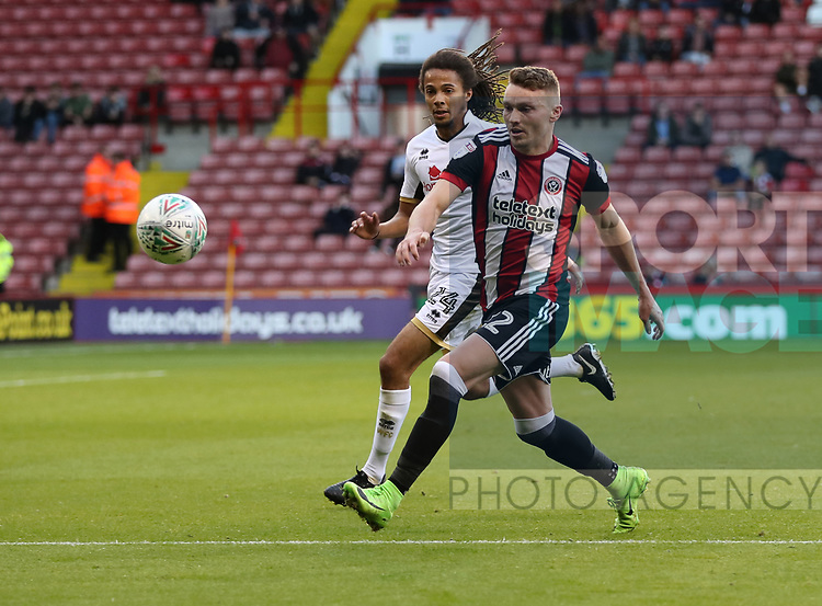 Caolan Lavery of Sheffield Utd in action with Kory Roberts of Walsall during the Carabao Cup round One match at Bramall Lane Stadium, Sheffield. Picture date 9th August 2017. Picture credit should read: Jamie Tyerman/Sportimage