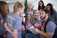 NWA Democrat-Gazette/CHARLIE KAIJO Greer Lingle Middle School Quiz Bowl coach Kyle Schoeller (right) strategizes with his team, Monday, December 2, 2019 during the middle school Quiz Bowl at the Center for Non-profits in Rogers.<br /> <br /> Students from all four Rogers middle schools and two teams from Rogers elementary schools, Frank Tillery Elementary and Mathias Elementary, participated in the statewide middle school level Quiz Bowl. Teams of five students test their knowledge and quick recall using a buzzer.