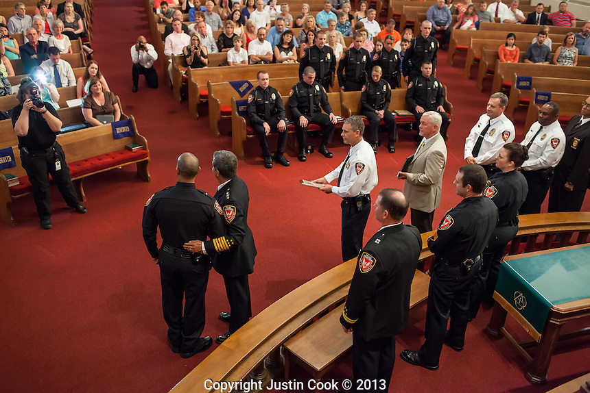 Copyright Justin Cook   July 23, 2013<br /> <br /> Ten Durham Police Department cadets graduate in the Basic Law Enforcement Training Class #37 at Duke Memorial United Methodist Church.