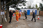 Wealdstone 0 Newport County 0, 17/03/2012. St Georges Stadium, FA Trophy Semi Final. Supporters giving money to a representative of the military collecting for 'Help for Heroes' outside St Georges Stadium, home ground of Wealdstone FC, before the club played host to Newport County in the semi-final second leg of the F.A. Trophy. The game ended in a goalless draw, watched by a capacity crowd of 2,092 which meant the visitors from Wales progressed by three goals to one to the competition's final at Wembley, where they would meet York City. The F.A. Trophy was the premier cup competition for non-League clubs in England and Wales affiliated to the Football Association. Photo by Colin McPherson.