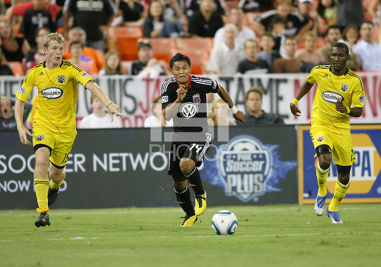 Andy Najar #14 of D.C. United breaks between Kevin Burns #15 and Shaun Francis #29 of the Columbus Crew during an MLS match at RFK Stadium on September 4 2010, in Washington DC. Columbus won 1-0.