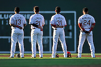 Greenville Drive infielders Rafael Devers, Nick Longhi, Javier Guerra and Yoan Moncada, left to right, pause for the National Anthem before a game against the Greensboro Grasshoppers on Tuesday, August 25, 2015, at Fluor Field at the West End in Greenville, South Carolina. Greensboro won, 3-2. (Tom Priddy/Four Seam Images)