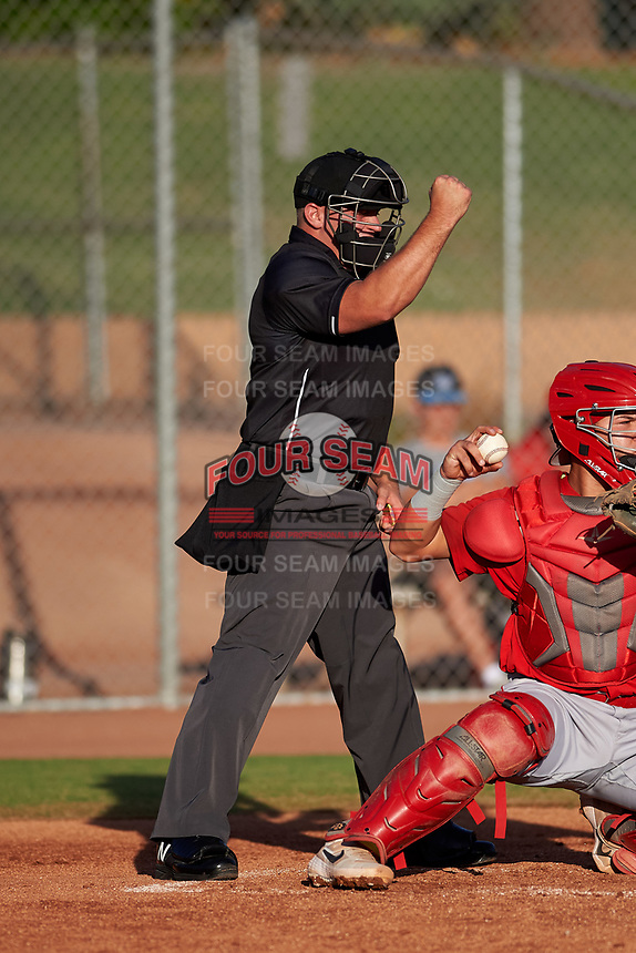 Home plate umpire Luke Morris calls a strike on a batter during a game between the AZL Angels and AZL Giants Orange at Giants Baseball Complex on June 17, 2019 in Scottsdale, Arizona. AZL Giants Orange defeated AZL Angels 8-4. (Zachary Lucy/Four Seam Images)