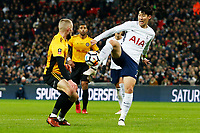 Son Heung-min of Tottenham Hotspur is marked by Dan Butler of Newport County during the Fly Emirates FA Cup Fourth Round Replay match between Tottenham Hotspur and Newport County at Wembley Stadium, London, England, UK. 07 February 2018