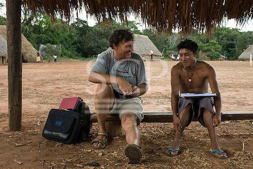 Xingu Indigenous Park, Mato Grosso State, Brazil. Aldeia Moygu (Ikpeng). Patrick Cunningham and Kay Yukwari Ikpeng, translator and radio programme maker.