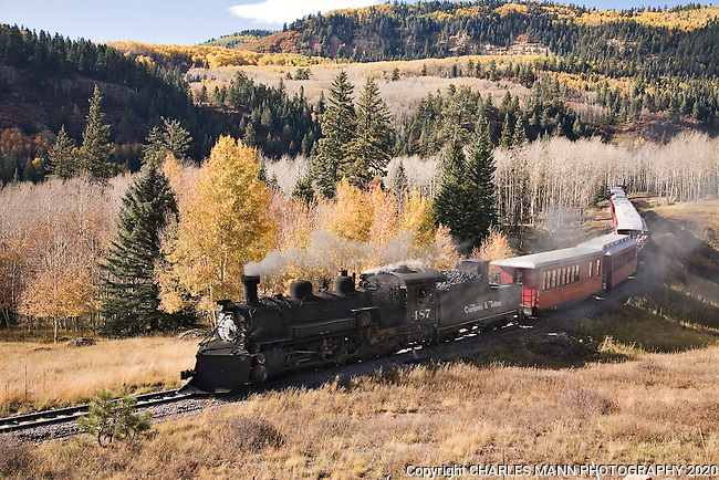 The Cumbres & Toltec steam railroad slides down the mountain on a fall day as it returns from a run near Chama, New Mexico
