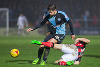 Max Kretzschmar of Wycombe Wanderers is tackled by Alan Goodall of Morecambe during the Sky Bet League 2 match between Wycombe Wanderers and Morecambe at Adams Park, High Wycombe, England on 2 January 2016. Photo by Andy Rowland / PRiME Media Images