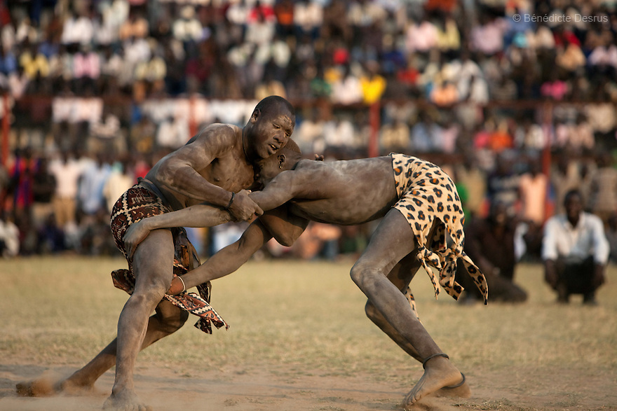 Sunday 5 december 2010 - Juba, Southern Sudan - Traditional wrestling matches in Juba Stadium between Dinka wrestlers from Yirol East of Lake State and Mundari wrestlers from Terekeka County of Central Equatoria State. The matches attracted large numbers of spectators who sang, played drums and danced in support of their favorite wrestlers. The match organizers hoped that the sport would bring together South Sudan's many different tribes.Photo credit: Benedicte Desrus