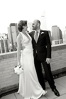 A playful candid of bride and groom on a terrace in NYC.