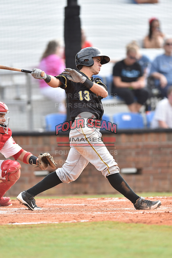 Bristol Pirates center fielder Eduardo Figueroa #13 swings at a pitch during a game against the Johnson City Cardinals at Howard Johnson Field July 20, 2014 in Johnson City, Tennessee. The Pirates defeated the Cardinals 4-3. (Tony Farlow/Four Seam Images)