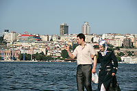 Young couple walking by the Golden Horn, Istanbul, Turkey