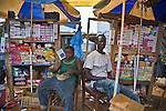 Boxes of Prudence Plus condoms hang on the shelves of this outdoor kiosk in Guinea's capital city of Conakry.  Prudence Plus is distributed by the international social marketing organization, Population Services International.