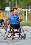 Bartolome Martinez dribbles the basketball while pushing his wheelchair forward during practice in Zipolite, a town in Oaxaca, Mexico. Martinez plays on the Oaxaca Costa wheelchair basketball team.