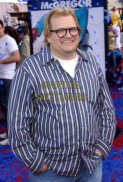 "DREW CAREY.The Twentieth Century Fox's Los Angeles Premiere of ""Robots"" held at The Mann Village Theatre in Westwood, California .March 6th, 2005.half length glasses goatee facial hair striped blue shirt.www.capitalpictures.com.sales@capitalpictures.com.Supplied By Capital PIctures"