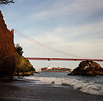 The Golden Gate Bridge as seen at sunset from Kirby Cove, a campground located in the Marin Headlands